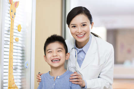 Cheerful doctor and boy in childrens hospital