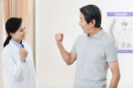 Cheerful female doctor and senior patient LANG_EVOIMAGES