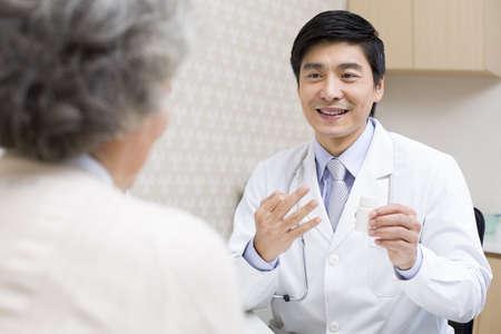 Doctor explaining dosage of medicine to patient