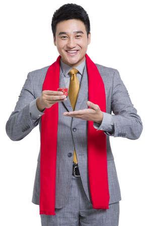 Cheerful businessman toasting