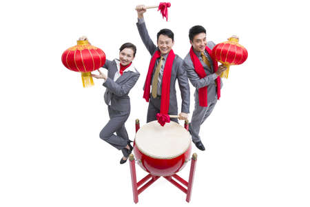 Cheerful business colleagues celebrating Chinese New Year LANG_EVOIMAGES