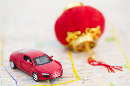 Toy car and Chinese lantern on road map LANG_EVOIMAGES