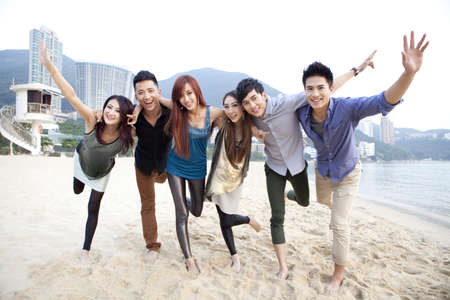Happy young people posing on the beach of Repulse Bay,Hong Kong