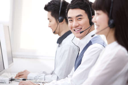 Professional customer service staff in office LANG_EVOIMAGES