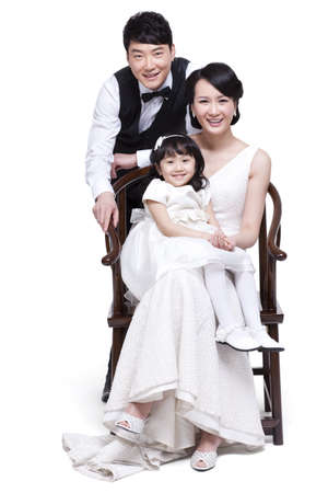 Portrait of happy young family LANG_EVOIMAGES