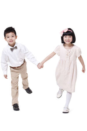 Cute boy and girl hand in hand