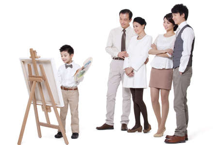 Cute boy drawing with his family