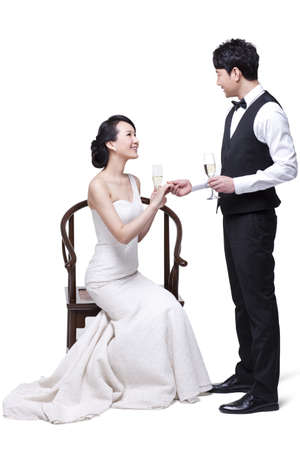 asian style: Romantic young couple with champagne flutes
