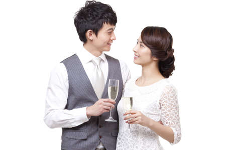 Romantic young couple having champagne