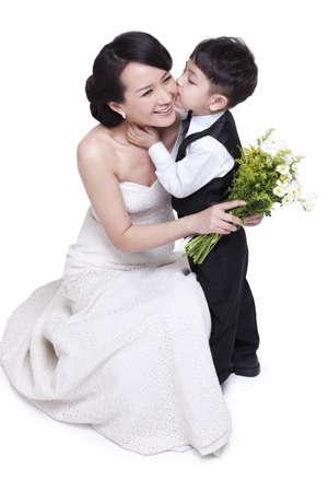 arm bouquet: Little boy kissing mother