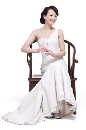 Young beautiful woman with champagne flute LANG_EVOIMAGES