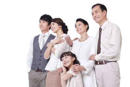 Happy family looking at view LANG_EVOIMAGES
