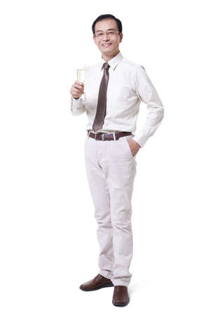 professional flute: Cheerful businessman holding champagne flute LANG_EVOIMAGES