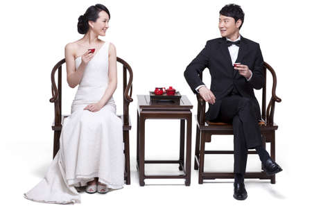 Elegant couple having tea LANG_EVOIMAGES
