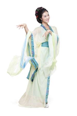 vistiendose: Mujer joven en el baile del traje tradicional china