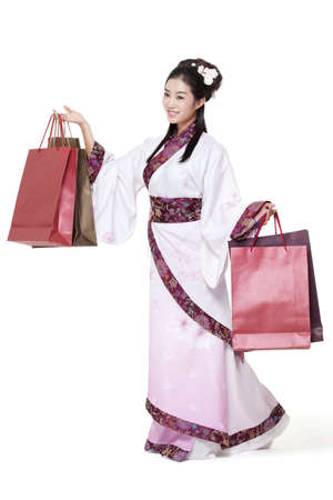Young woman in traditional Chinese costume with shopping bags