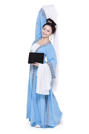 Young woman in traditional Chinese costume with digital tablet