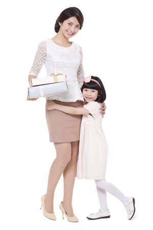 Happy mother and daughter with gift box LANG_EVOIMAGES