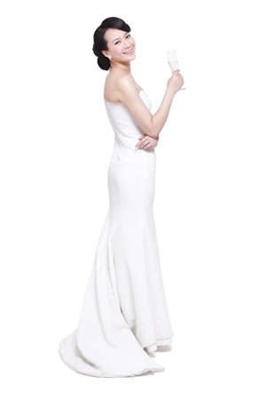 Graceful young woman with champagne flute LANG_EVOIMAGES