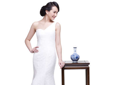Elegant young woman with Chinese blue and white porcelain
