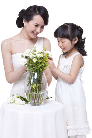 Giving flowers to mothers during wedding ceremony