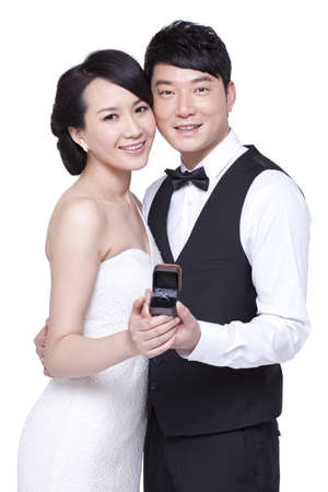 Happy young couple with diamond ring