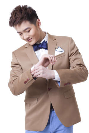 cuffs: Stylish businessman adjusting cuffs LANG_EVOIMAGES