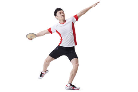 Male athlete throwing discus