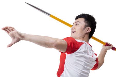 javelin: Male athlete throwing javelin LANG_EVOIMAGES