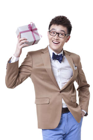 Fashionable businessman with a gift