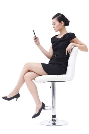 chairs: Fashionable businesswoman with mobile phone LANG_EVOIMAGES
