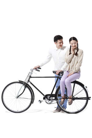 Sweet retro couple with an old-fashioned bicycle
