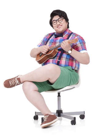 plucking: Happy overweight man playing small guitar LANG_EVOIMAGES