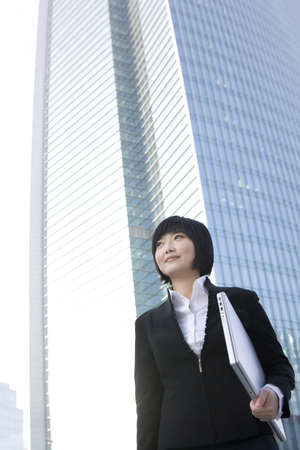 world at your fingertips: Businesswoman with laptop LANG_EVOIMAGES