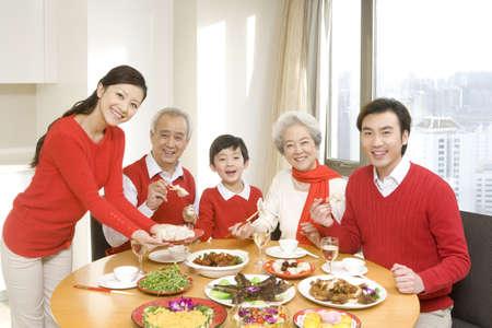 three generations enjoying a chinese new year dinner together stock photo 74919808 - Chinese New Year Dinner