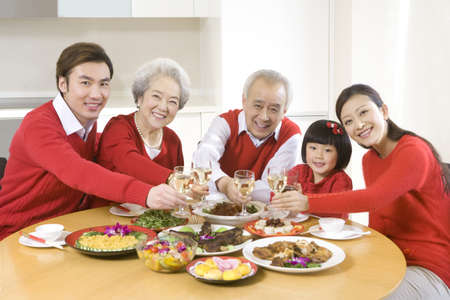 family: Three generations enjoying a Chinese New Year dinner together