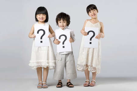 punctuation mark: Children holding signs with question marks LANG_EVOIMAGES