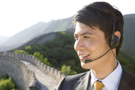 mutianyu: Businessman with headsets on the Great Wall