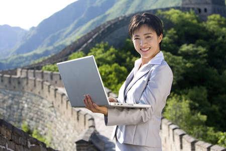 mutianyu: Businesswoman working on the Great Wall