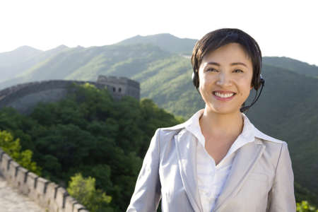 mutianyu: Businesswoman with headsets on the Great Wall