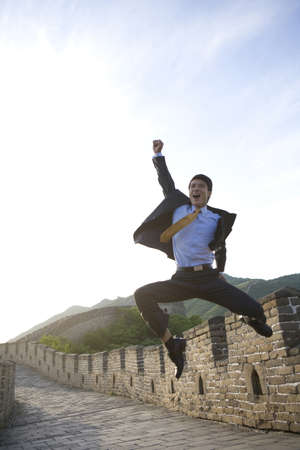 Happy businessman on the Great Wall