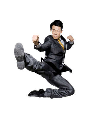 punched out: Businessman in martial arts position mid-air