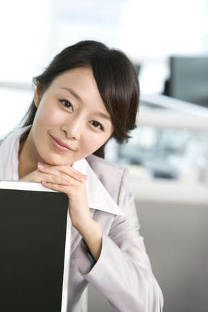 technology: Office worker at her desk