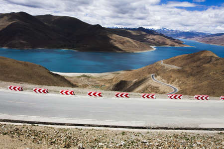 swerving: Road and Yamdrok Yamtso lake in Tibet, China