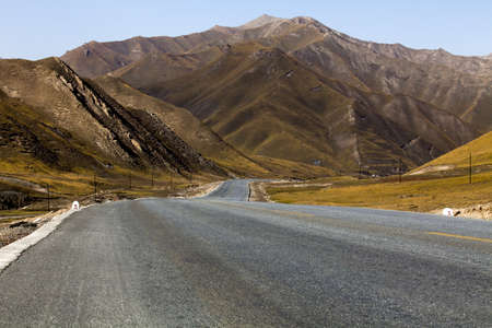 swerving: Road going through wilderness area into Qilian Mountain in Qinghai province,China