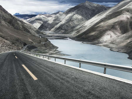 swerving: Mountain  road and lake in Tibet, China