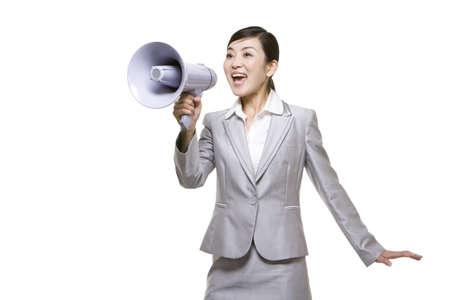 Businesswoman Shouting Into Megaphone LANG_EVOIMAGES