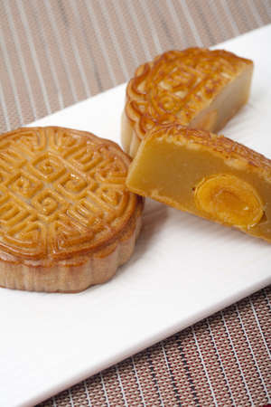 four objects: Cut Moon Cake on a Modern Rectangular Plate