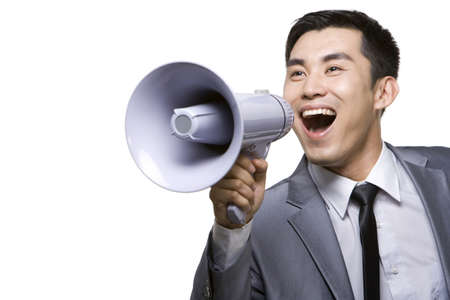 businessman using a megaphone: Businessman Shouting Into Megaphone