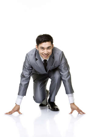 Businessman in track starting position
